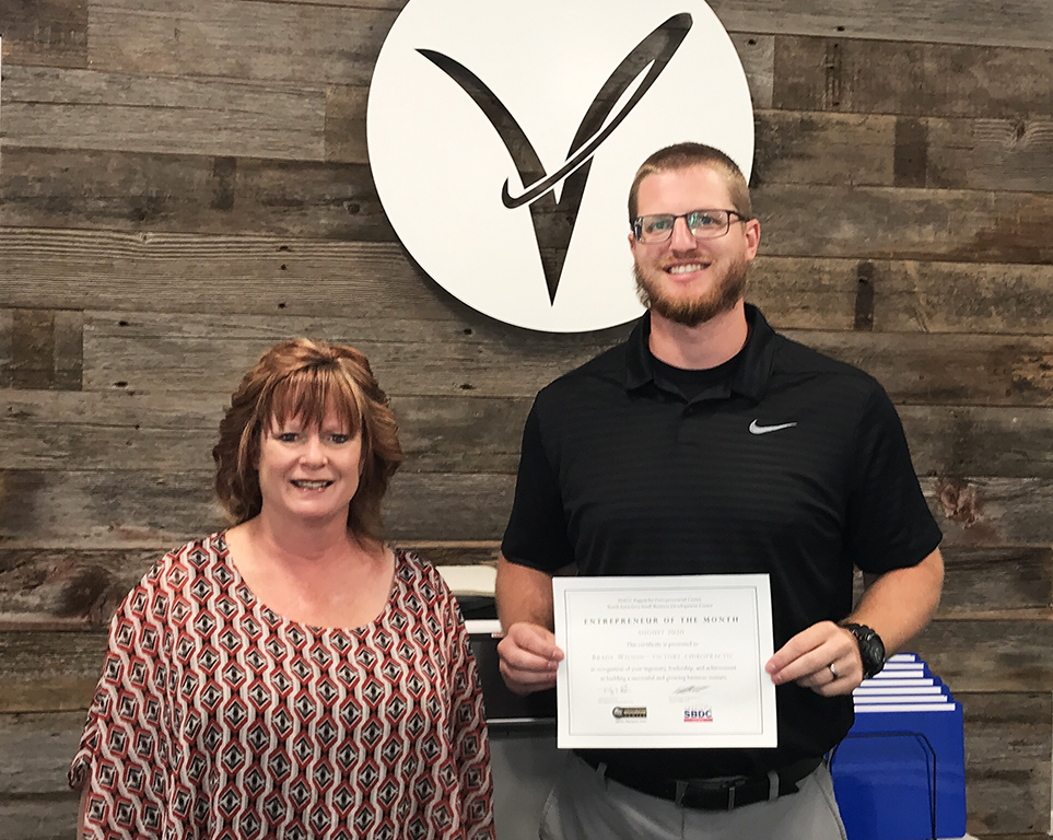 Dr. Brady Wilson of Victory Chiropractic and Jill Kramer of Hancock County Economic Development